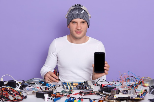 Image of confident professional radiotrician sitting at his workplace Free Photo