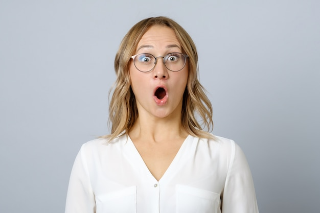 Image of excited young woman isolated Premium Photo