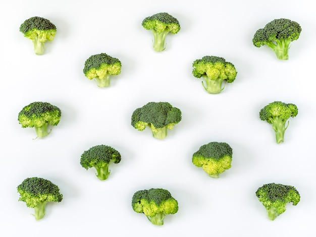 Image of a group of raw broccoli placed on a white cardboard Premium Photo