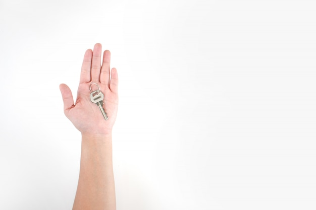 The image in the hands of asian people has keys on a white background. Premium Photo