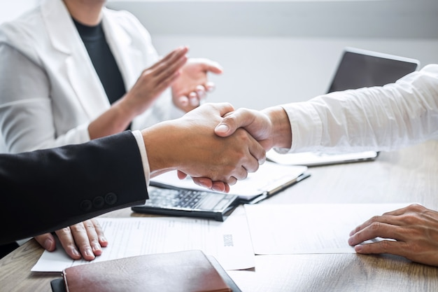 Image of recruiter in suit and new employee shaking hands and clap after good deal interviewing Premium Photo