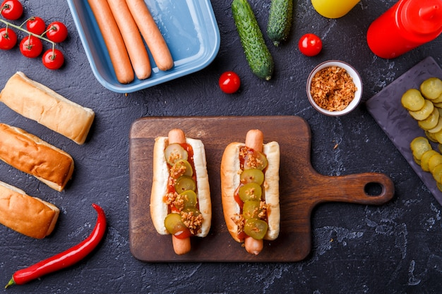 Image on top of two hotdogs on cutting board on table Premium Photo