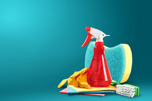 Image with various tools for cleaning the premises and cleaning agents on a blue background Premium Photo