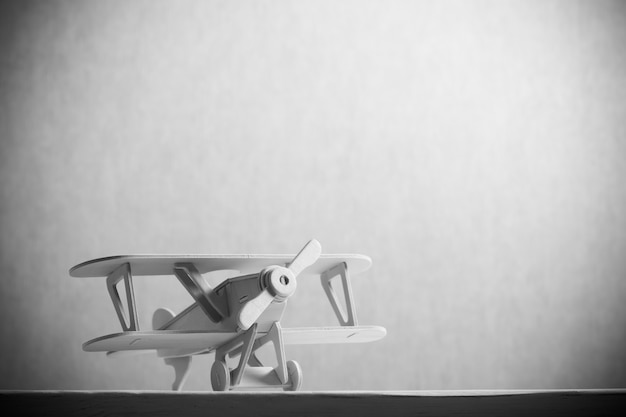 Image of wooden toy airplane over wooden table. retro style image Premium Photo