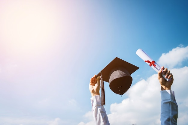 Images of graduates are celebrating graduation put hand up Premium Photo