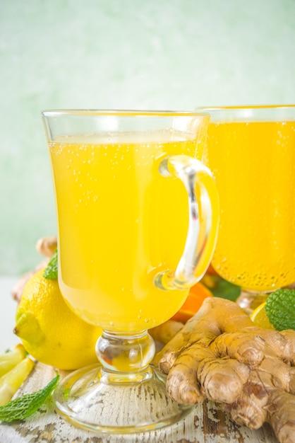 Immune boosting natural vitamin healthy drink for resist virus. fresh organic ginger and citrus juice Premium Photo