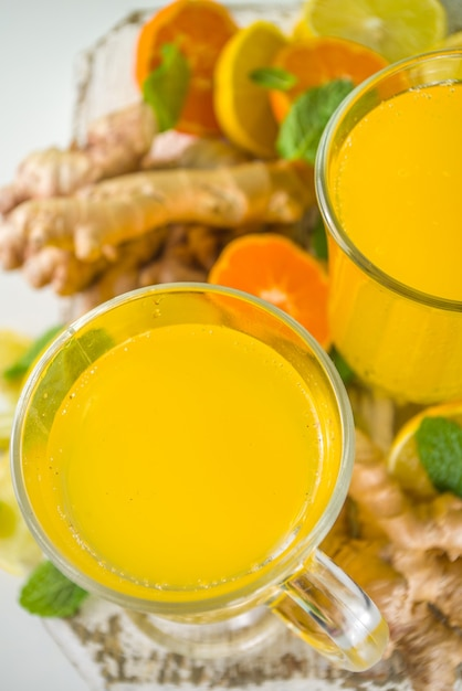 Immune boosting natural vitamin healthy drink for resist virus. fresh organic ginger and citrus juice Premium Photo