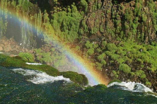 Impressive view of a huge rainbow over the iguazu falls, foz do iguacu, brazil, south america Premium Photo