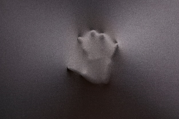 Imprint of hand on fabric Free Photo