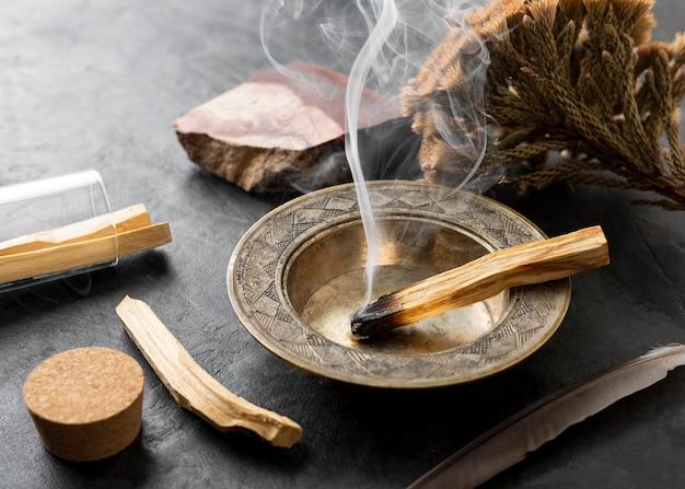 Incense spanish holy wood plant and smoke Premium Photo