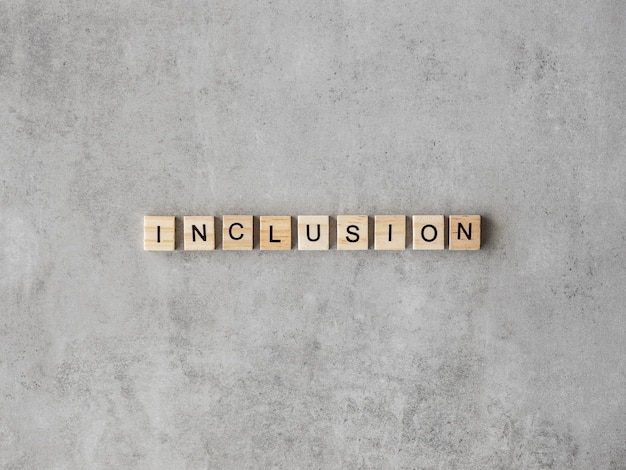 Inclusion word written in scrabble letters on marble background Free Photo