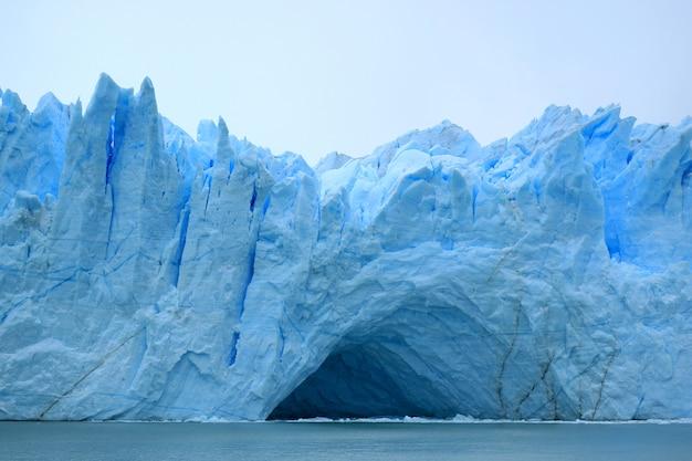 Incredible view of the ice blue perito moreno glacier's huge front wall, el calafate Premium Photo