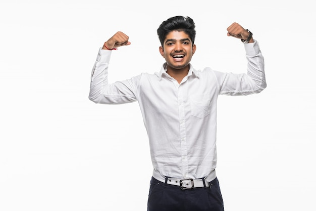 Indian business man flexing his biceps. concept about power and strength. Free Photo
