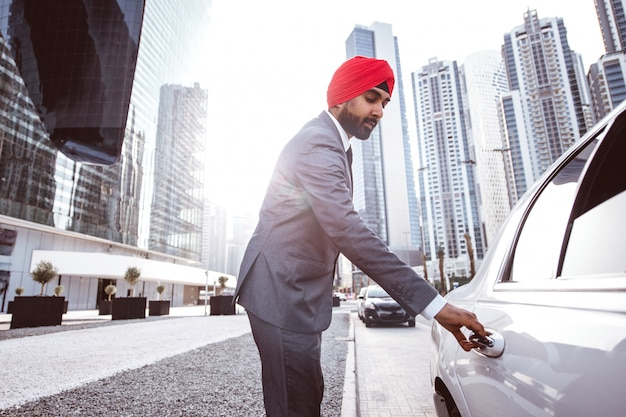 Indian businessman his  company car in india Premium Photo