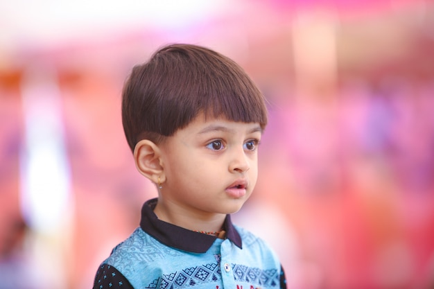 Indian child playing in outdoor Premium Photo