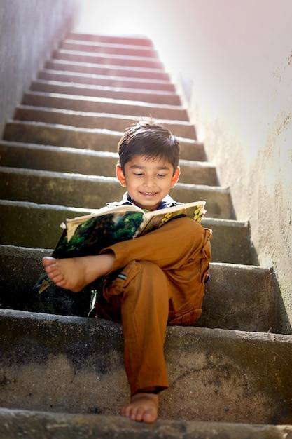 Indian child studying Premium Photo