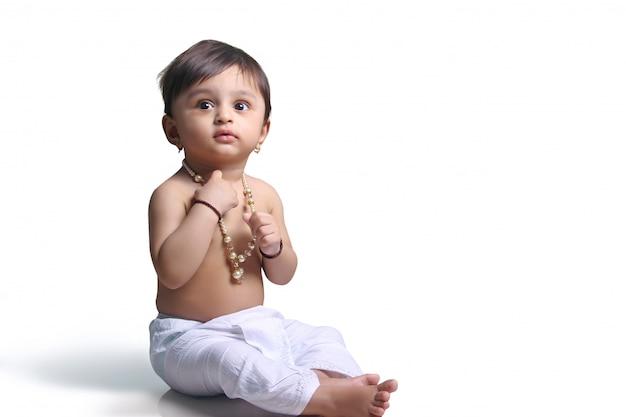Indian child on traditional dhoti Premium Photo