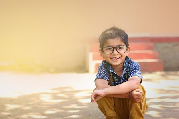 Indian child wear eyeglass Premium Photo