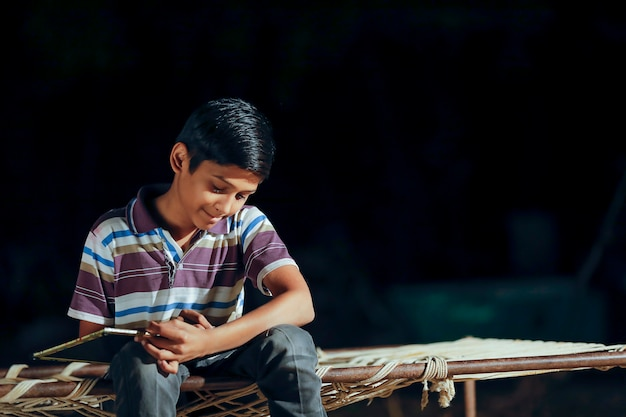 Indian child with slate Premium Photo