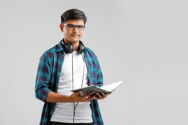 Indian collage boy with headphones Premium Photo
