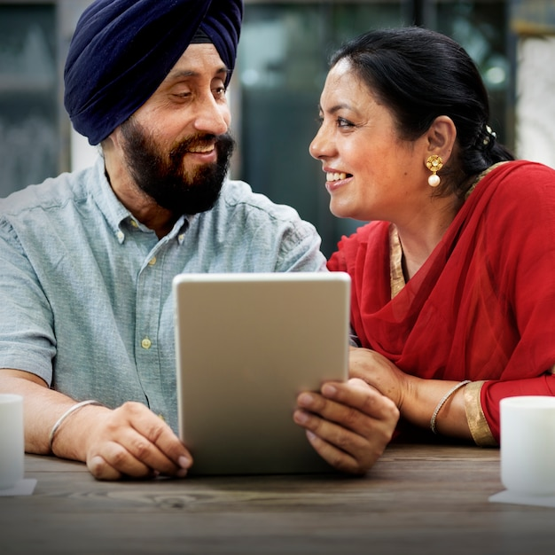 Indian couple using device concept Free Photo