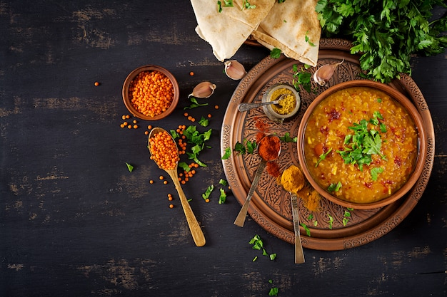 Indian dhal spicy curry in bowl Premium Photo