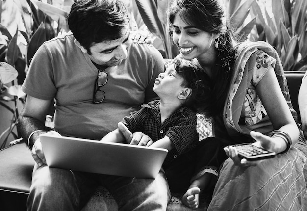 Indian Family Using A Laptop Together Photo Free Download
