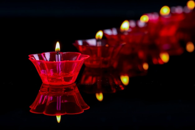 Indian festival diwali, colorful lamps of oil on black Premium Photo