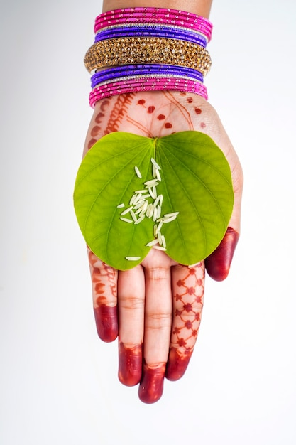 Indian festival dussehra, green apta leaf in hand Premium Photo