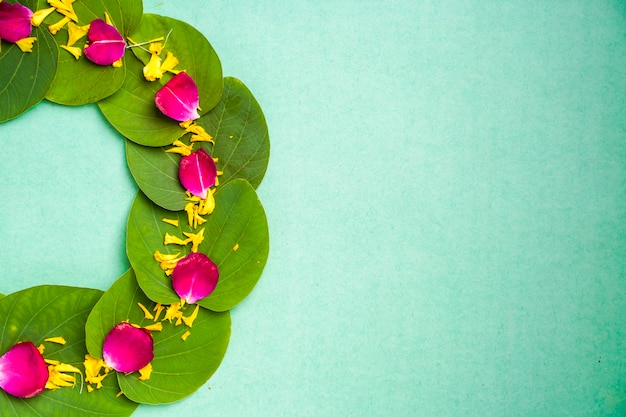 Indian festival dussehra , green leaf, rice and flowers Premium Photo