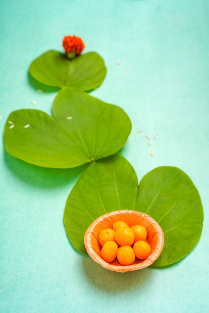 Indian festival dussehra , green leaf and rice Premium Photo