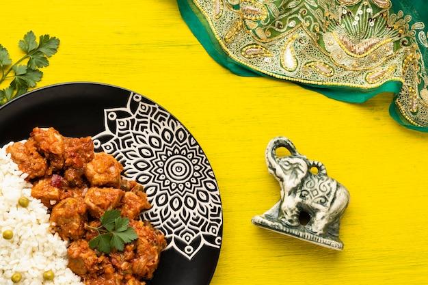 Indian food assortment with sari flat lay Free Photo