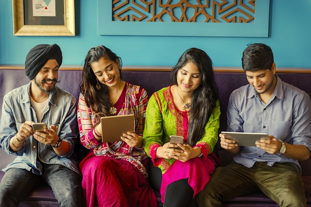 Premium Photo | Indian friends using social media