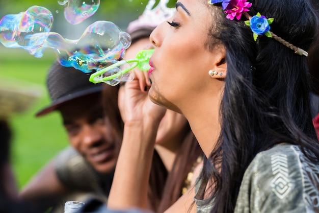 Indian girl blowing soap bubbles Premium Photo