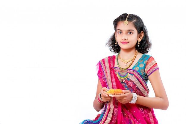 Indian girl celebrating diwali festival Premium Photo