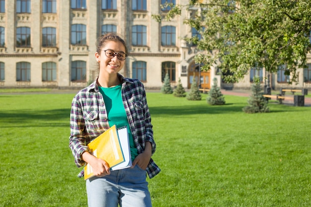 Indian girl student with books. Premium Photo