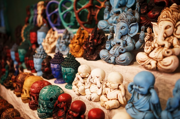 Indian gods souvenirs on the counter of the night market for tourists Premium Photo