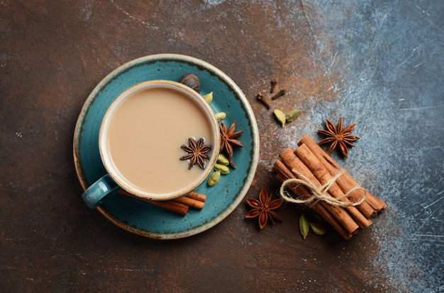 Indian masala chai tea. spiced tea with milk on dark rusty top view, flat lay. Premium Photo