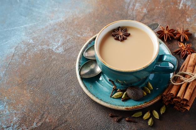 Indian masala chai tea. spiced tea with milk. Premium Photo