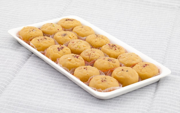 Indian most popular sweet food variety of peda Premium Photo