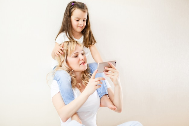Indian mother and child playing game on the smartphone Photo
