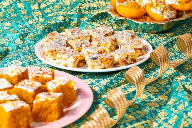 Indian popular sweet food sugar free dry fruits with mung dal chakki or chandrakala Premium Photo