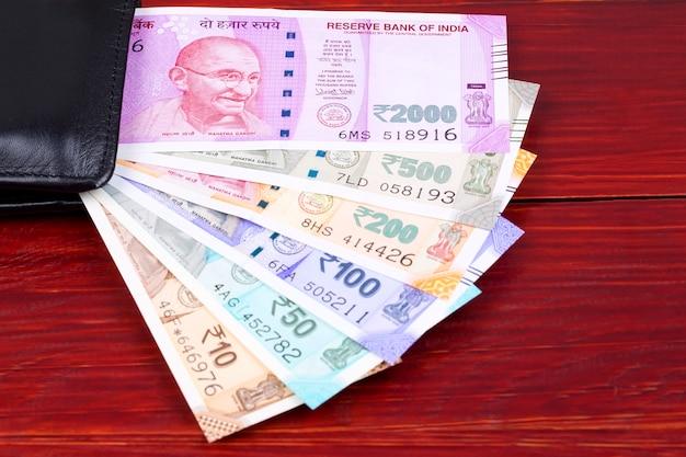Indian rupee in the black wallet Premium Photo