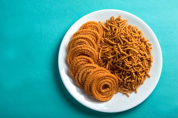 Indian snack : besan (gram flour) sev and chakli, chakali or murukku. Premium Photo