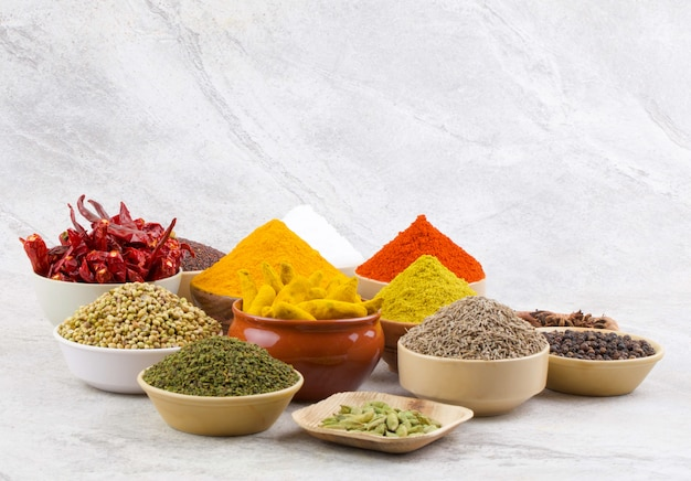 Indian spices collection on vintage background Premium Photo
