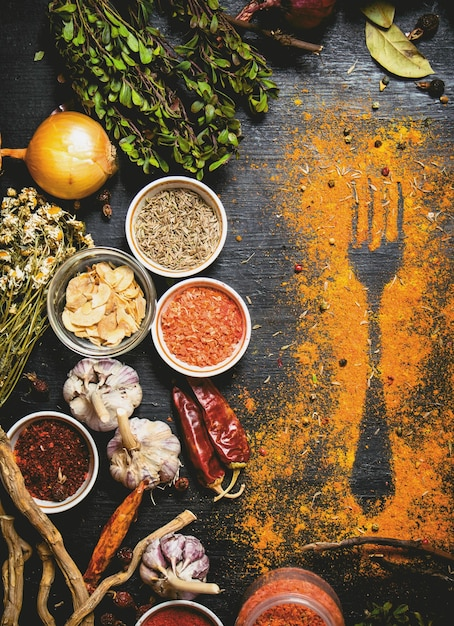 Indian spices and herbs. print of ground spices on the table. on the black chalkboard. Premium Photo
