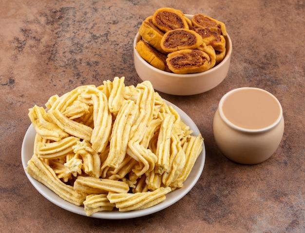 Indian spicy snack ghatiya with bhakarwadi Premium Photo