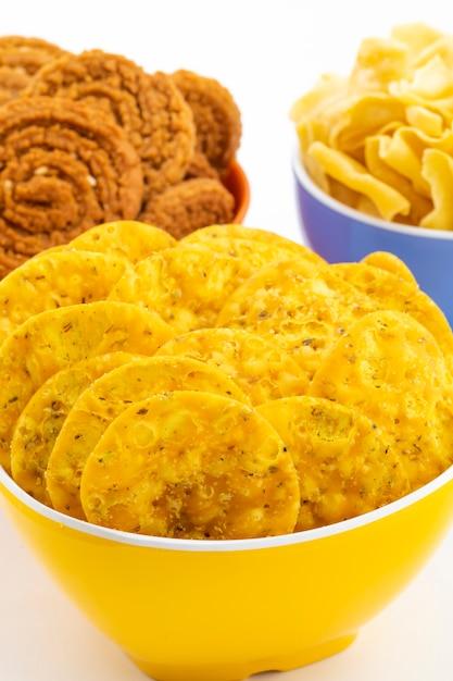 Indian street snack masala khari papdi with besan papri or chakli Premium Photo