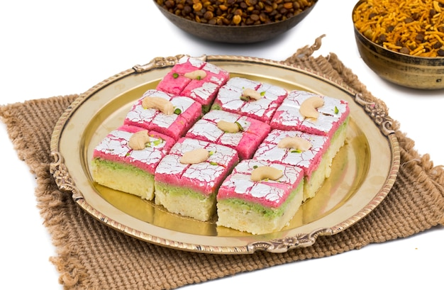 Indian sweet food dryfruit barfi on white background Premium Photo