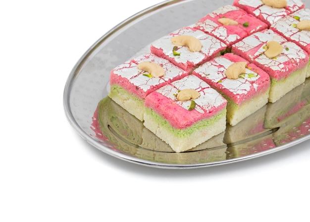 Indian sweet food dryfruit barfi on white background Premium Photo